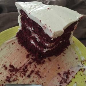 Ragged slice of red velvet cake